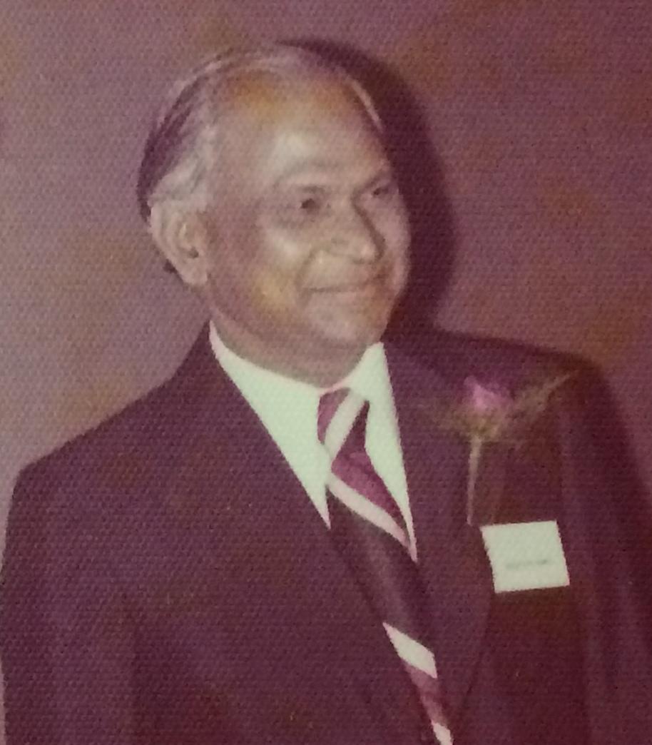 Abbaji in a suit