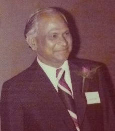Abbaji in a suit